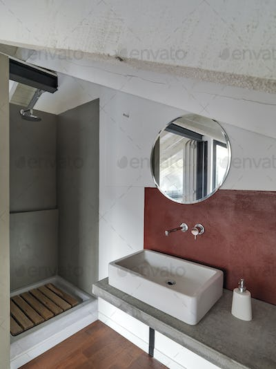 Interiors of the Modern Bathroom in the Industrial Style Penthouse
