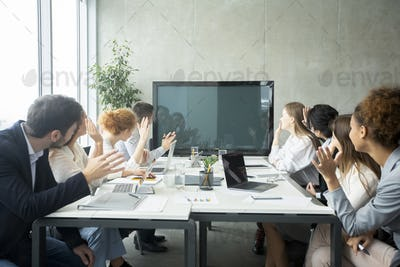 Videoconference. Businesspeople greeting boss, waving hands to screen