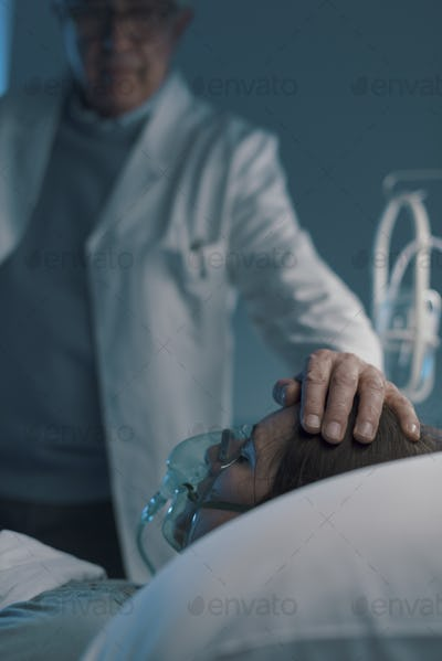 Doctor assisting a hospitalized patient at night