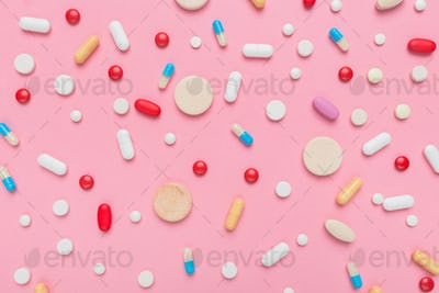Variety of pills and tablets medicine flat lay top view