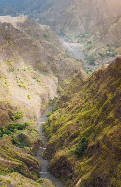 Santo Antao, Cape Verde. Canyon with steep cliff and winding riverbed with lush green vegetation on