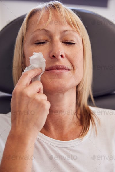Beautician Or Doctor Preparing Mature Female Patient For Botox Injection