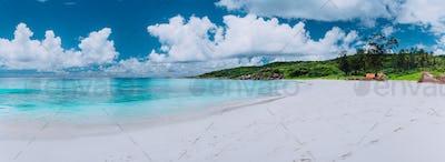 Idyllic panorama sea cloudscape of Grand Anse beach in La Digue island, Seychelles. Pristine white