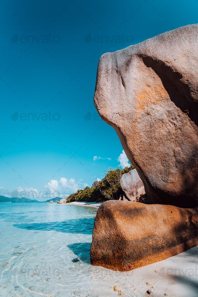 Huge beautifully shaped bizarre granite boulders in evening light at famous Anse Source d'Argent