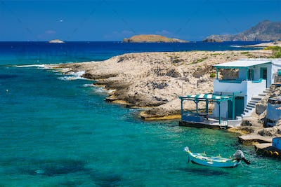 Crystal clear blue water at MItakas village beach, Milos island, Greece