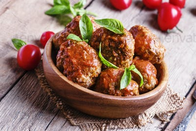 Meatballs with tomato sauce and basil