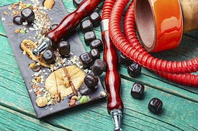Smoking hookah with chocolate
