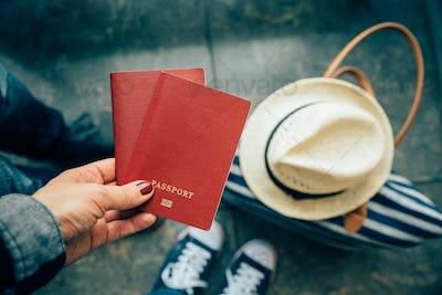Woman holding passports close up at airport