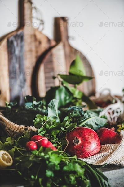 Fruit, vegetables, nut, greens over grey concrete kitchen counter