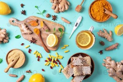 Healthcare, flu and cold treatment. Naturopathy concept. Ginger, lemon, honey, pills, drugs
