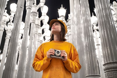 Young tourist with a retro camera at a famous place