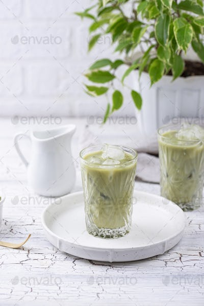Cold matcha tea with milk and ice