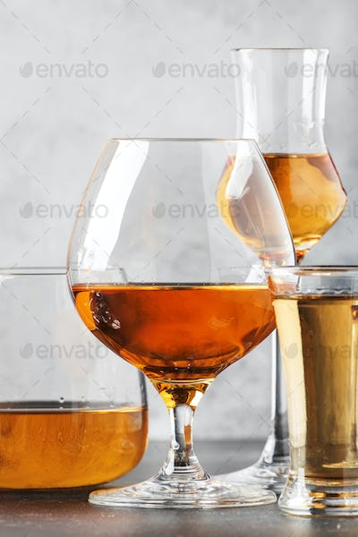 Set of hard strong alcoholic drinks and spirits in glasses in assortment