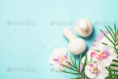 Spa herbal compressing balls on blue background