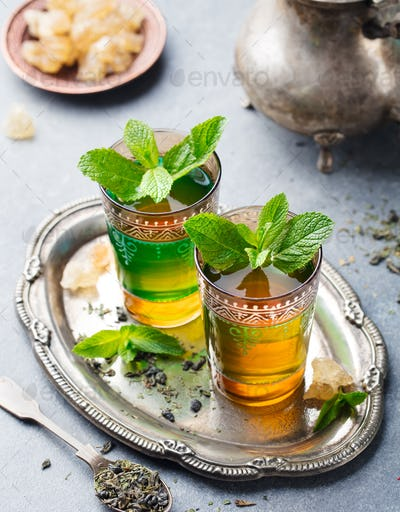 Mint tea, Moroccan traditional drink in glass. Close up.