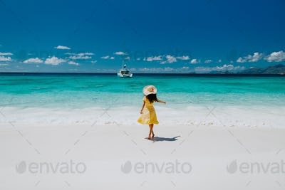 woman travel tropical beach resort with yacht view