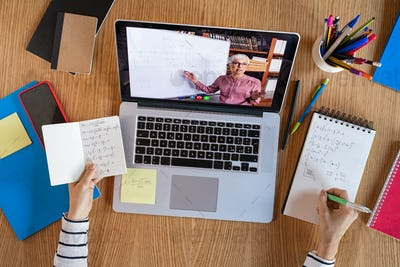 Student learning at home with online lesson