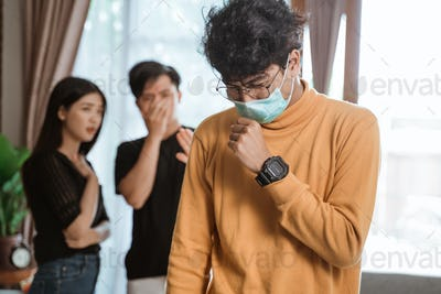Man coughing with protective masks