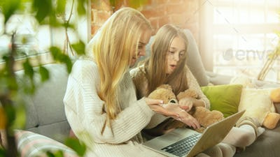 Happy loving family, mother and daughter spending time together at home