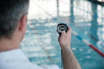 Checking time of swim lap