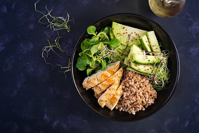 Buddha bowl with buckwheat porridge, grilled chicken fillet, corn salad, microgreens and daikon.