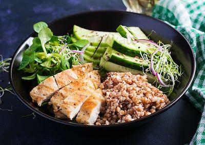 Buddha bowl with buckwheat porridge, grilled chicken fillet, corn salad, microgreens and daikon