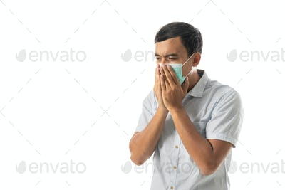 man wearing face masks and coughing