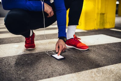 Choosing the right playlist for his workout