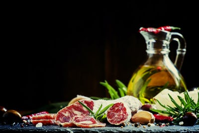 Jerked Italian salami with rosemary, spices, olives and oil