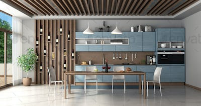 Blue and wooden kitchen with dining table