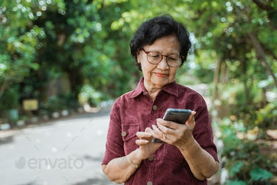 old woman enjoy using a smartphone