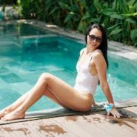 Pretty woman resting by pool