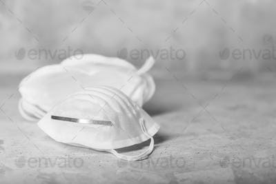 Anti coronavirus Covid-19 protective mask on concrete background