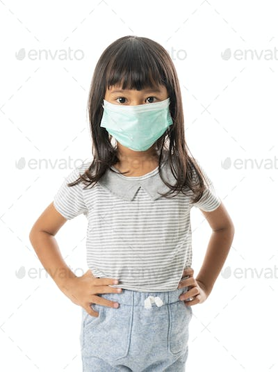 kid wearing face mask for virus protection