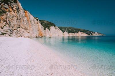Holiday vacation scene. Fteri beach on Kefalonia Island, Greece. Most beautiful pebble beach with