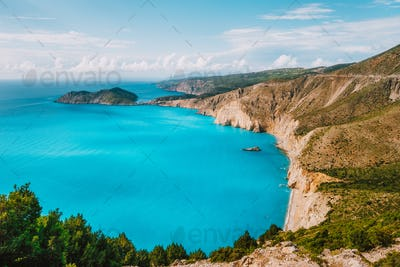 Kefalonia west coastline. Assos village town and Frourio peninsular. Beautiful blue bay with brown
