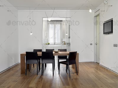 Interiors of the Modern Dining Room Overlooking on the Kitchen