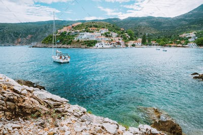 Assos cute town, on Kefalonia island, Greece. View of beautiful bay with sail yacht boat and
