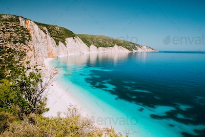 Holiday vacation. Fteri beach, Kefalonia, Greece. Calm clear blue emerald green turquoise sea with