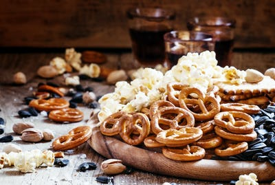 Salted straws in the shape of pretzels, popcorn and other salty snacks, junk food