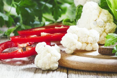 Cauliflower, red bell pepper, parsley, a still-life with fresh vegetables