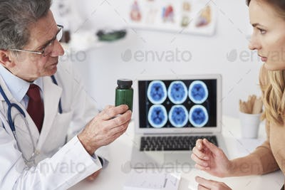 Doctor recommending vitamins to the patient