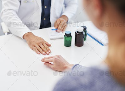 Close up of patient giving doctor the bribe