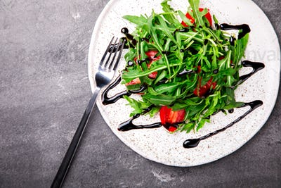 Salad with arugula , Fresh Cherry Tomatoes .Food or Healthy diet concept.