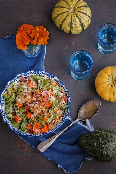 Salad with pumpkin,bacon , herbs