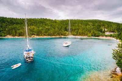 Foki beach near small town Fiskardo at Kefalonia, Ionian islands, Greece. Private yacht boats in the