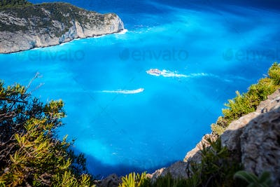 Navagio beach, Zakynthos, Greece. Tourist trip boats visiting and leaving Shipwreck bay with
