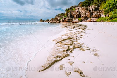 Surreal rock formation on Grand Anse beach located at La Digue island. Scenic landscape at