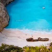 Close up of Shipwreck in Navagio beach. Azure turquoise sea water and paradise sandy beach. Famous