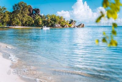 Seychelles. La Digue island famous Anse Source d'Argent beach. Pleasure tourist vacation boat in